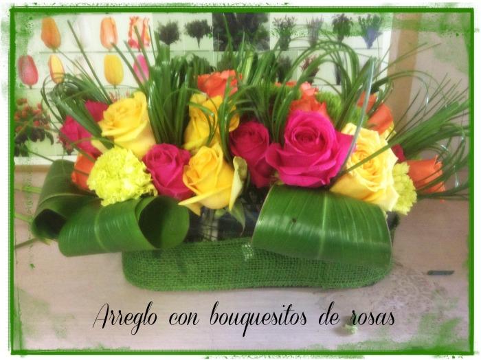 Arreglo de flores con bouquets de rosas
