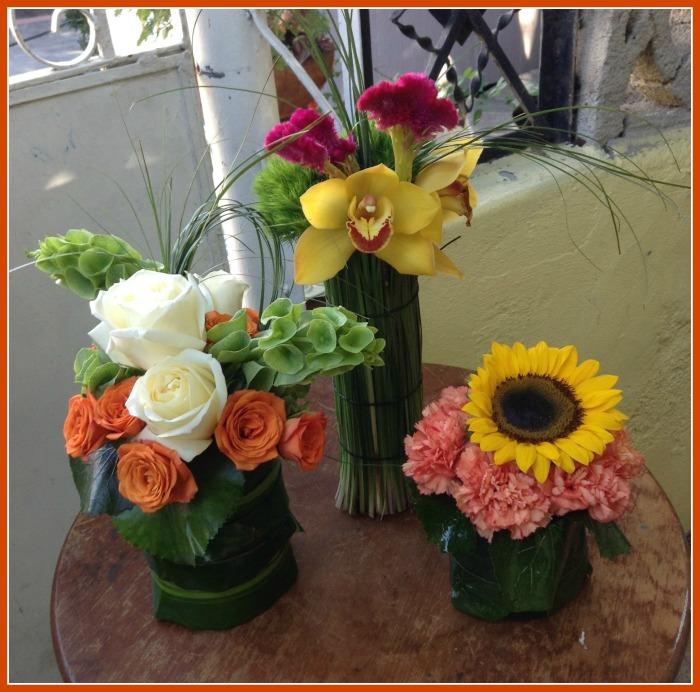Conjunto de cilindros con flores