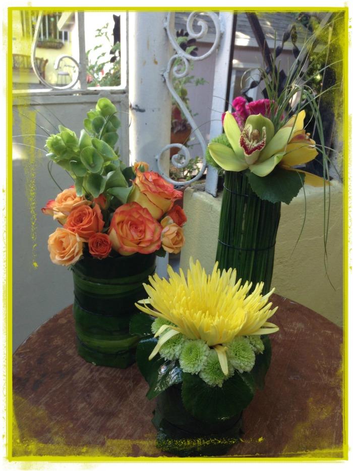 Conjunto de cilindros con flores variadas