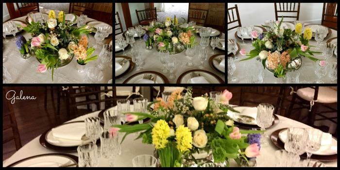 Ensaladera de plata con rosas y tulipanes, complementada con vasitos de plata y jacintos en diferentes colores.
